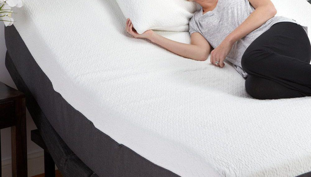 woman lying on an adjustable bed