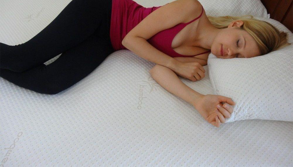 a sleeping woman suffering from a bad back