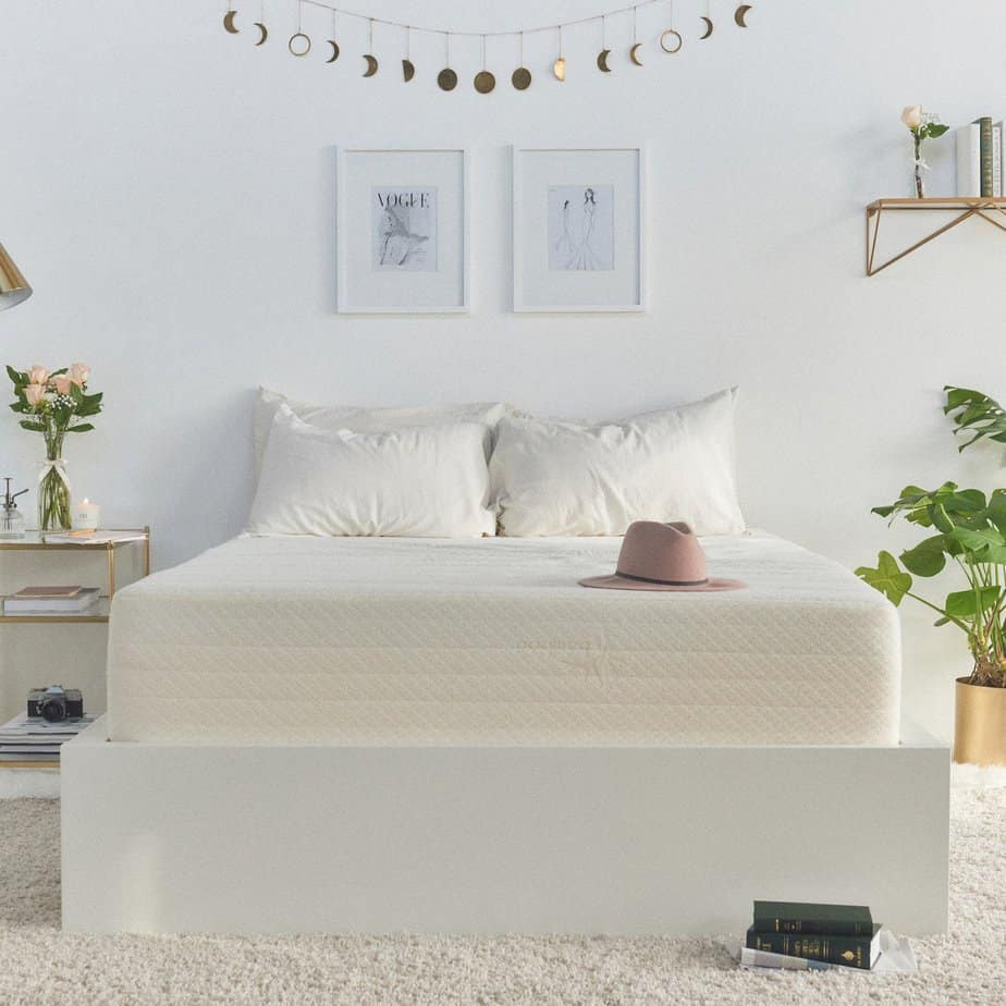 the Brentwood Home Cypress Mattress laid with pillows