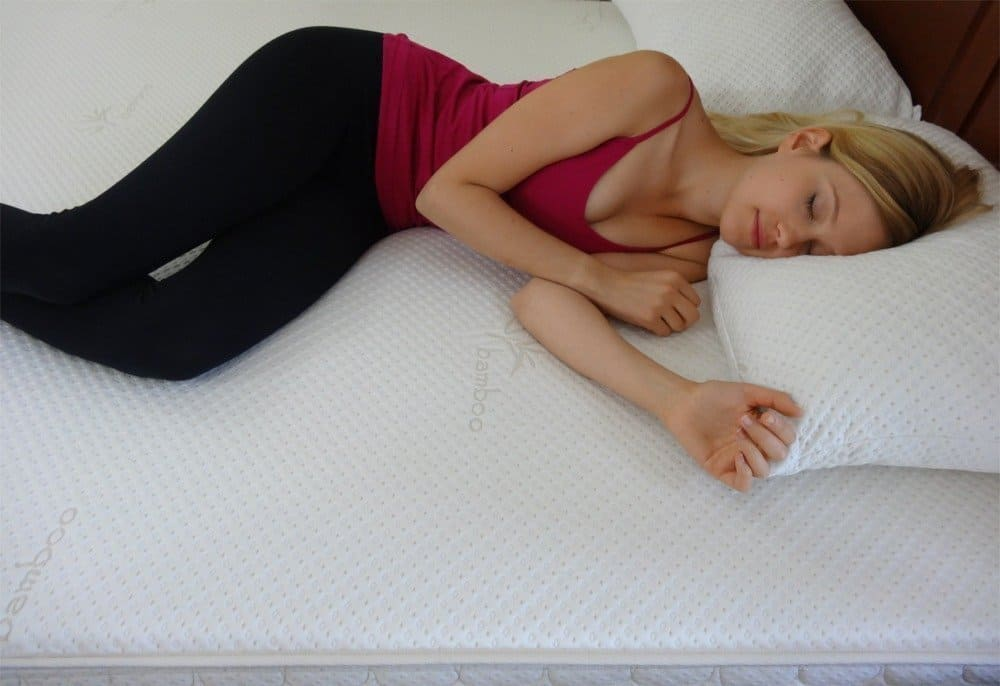 young woman asleep on a Snuggle-Pedic mattress