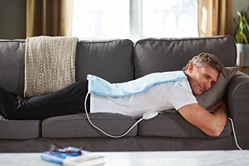 man taking a nap with the Sunbeam 732-500 heating pad