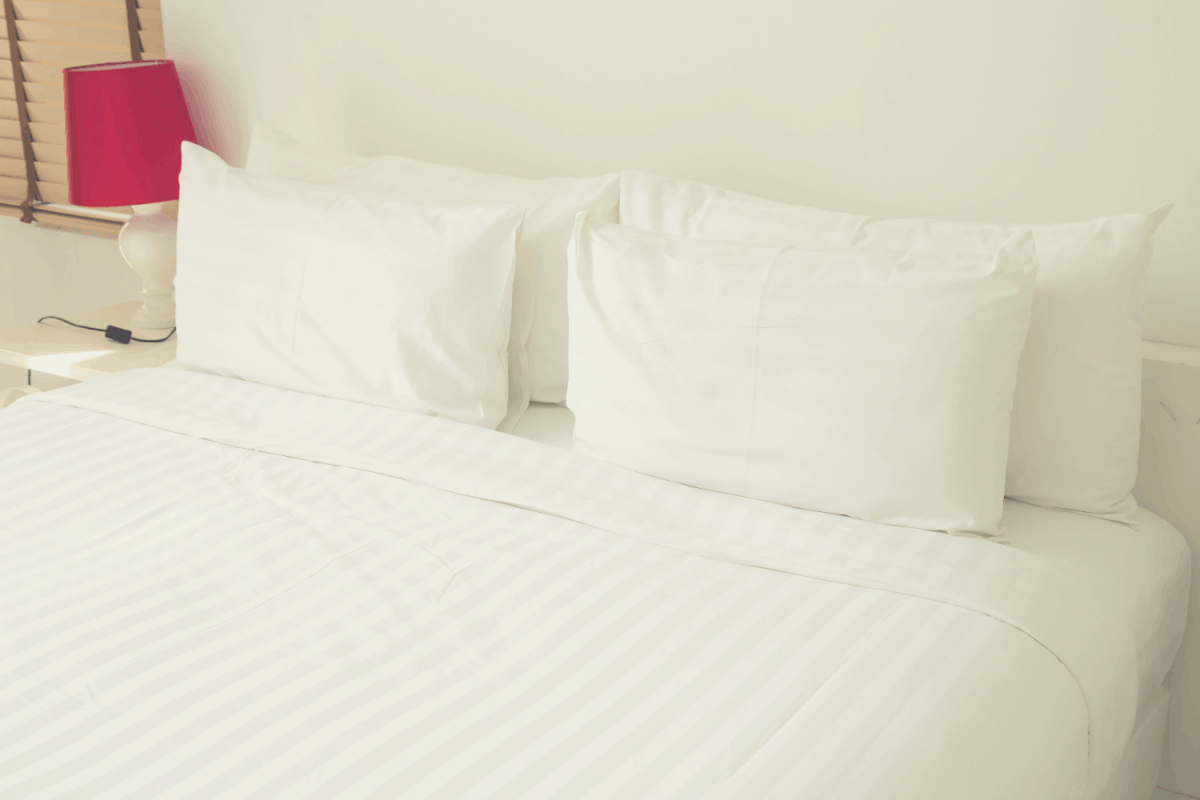 white premium bed sheets laid on a bed