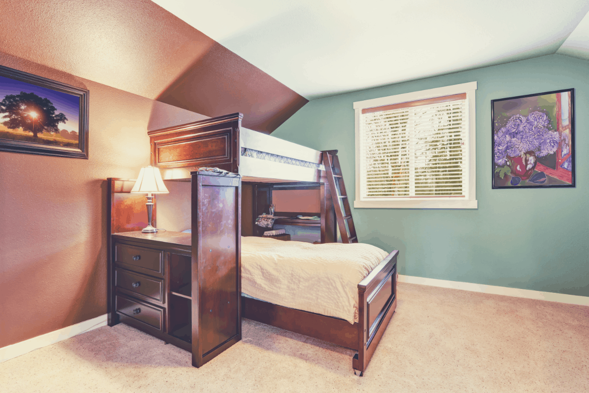 A loft bed placed in a kid's bedroom