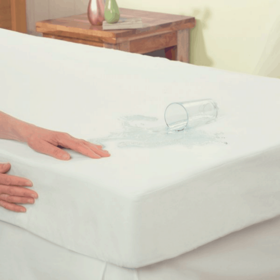 waterproof mattress protector with water poured on it