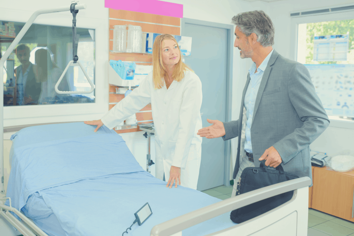 man asking a woman about an adjustable bed