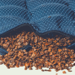 blue colored pillow filled with organic buckwheat hulls