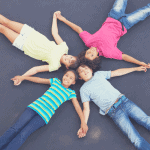 kids lying down on a trampoline