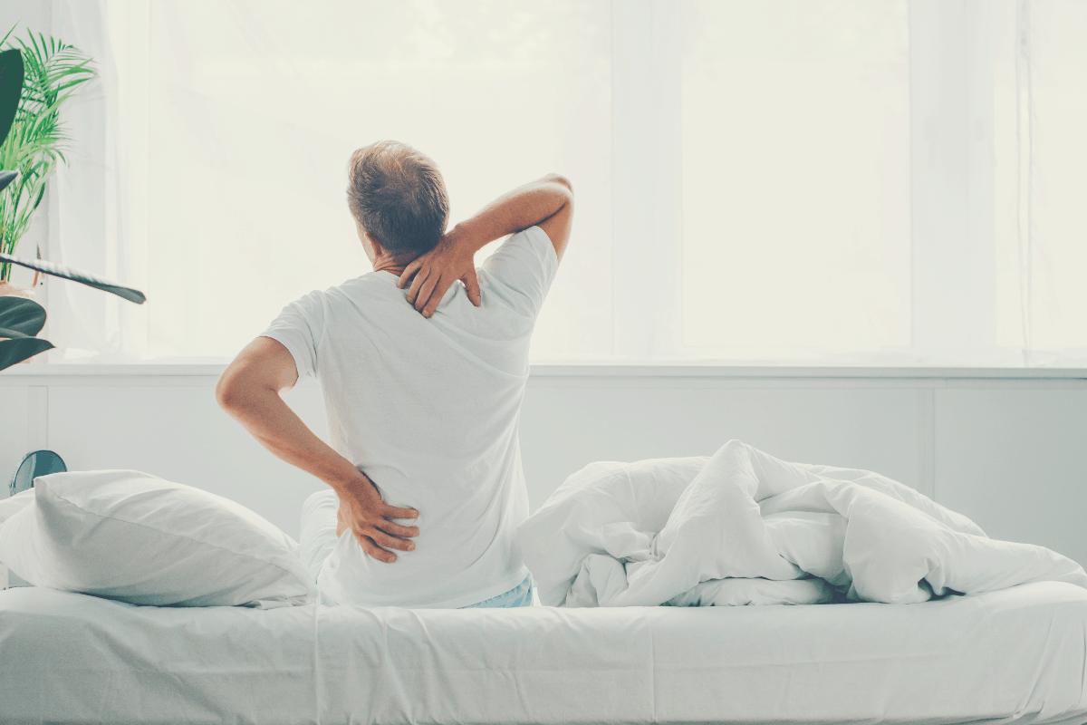 man waking up with backache