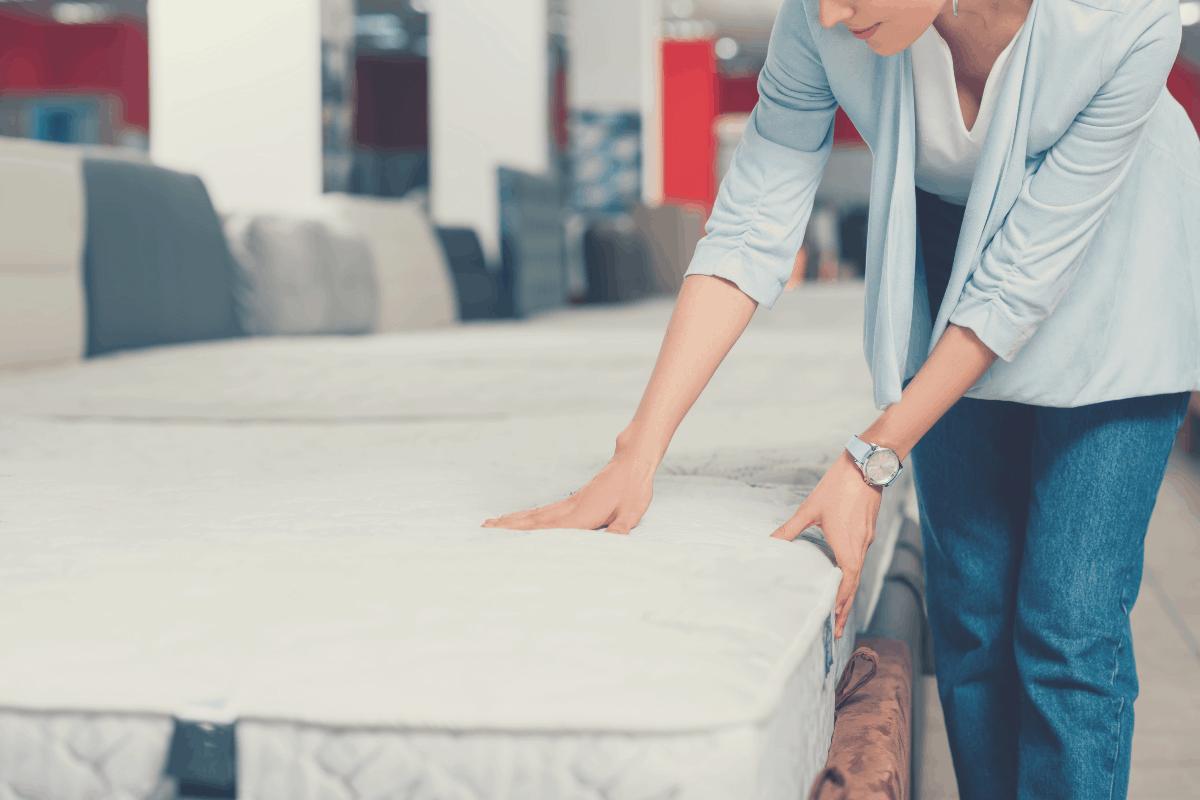 lady feeling the firmness of a mattress