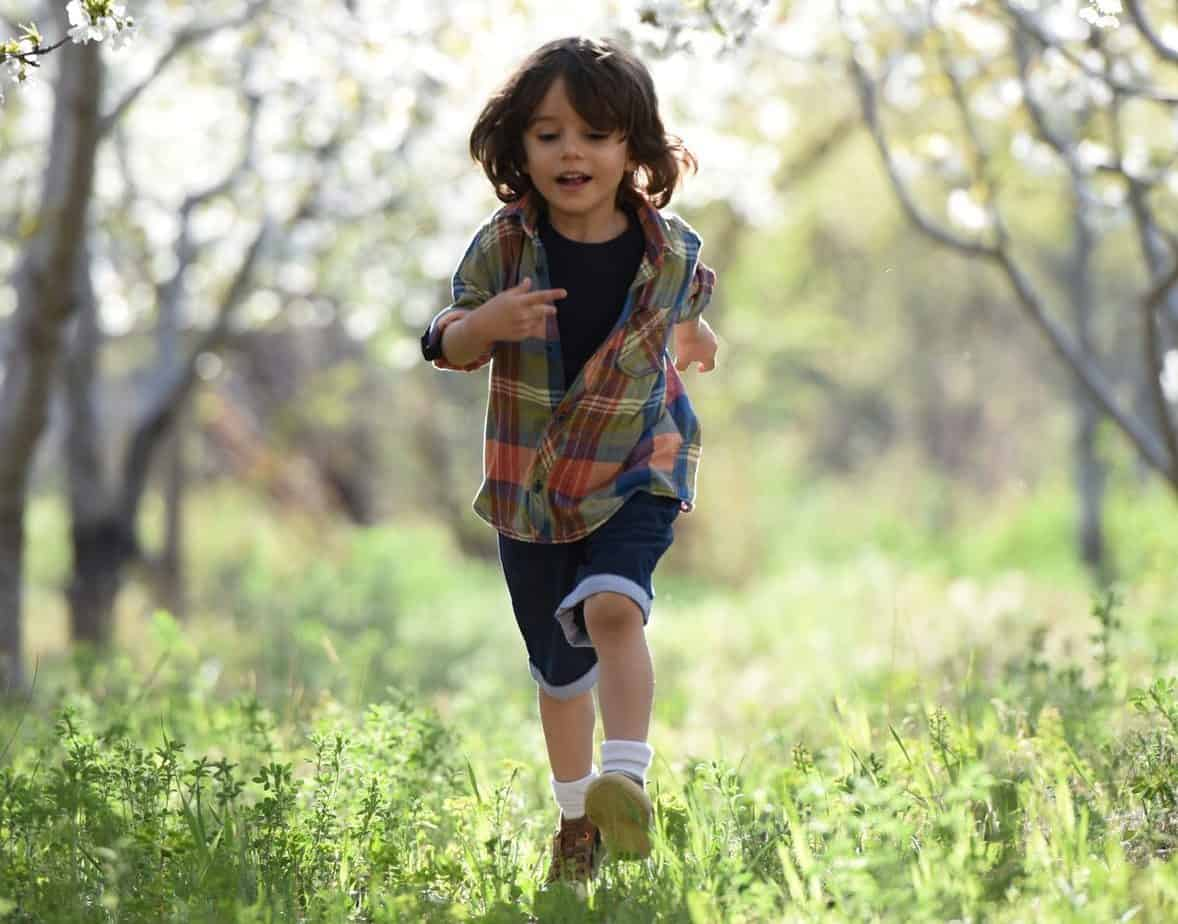 kid running in the woods