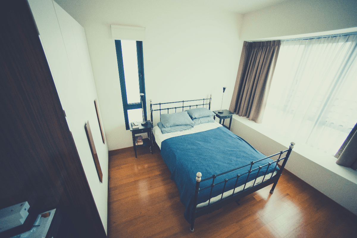 metal bed frame with blue and white bedshets