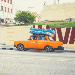 taxi carrying mattresses