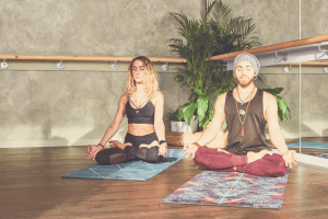 couple meditating in a bright room