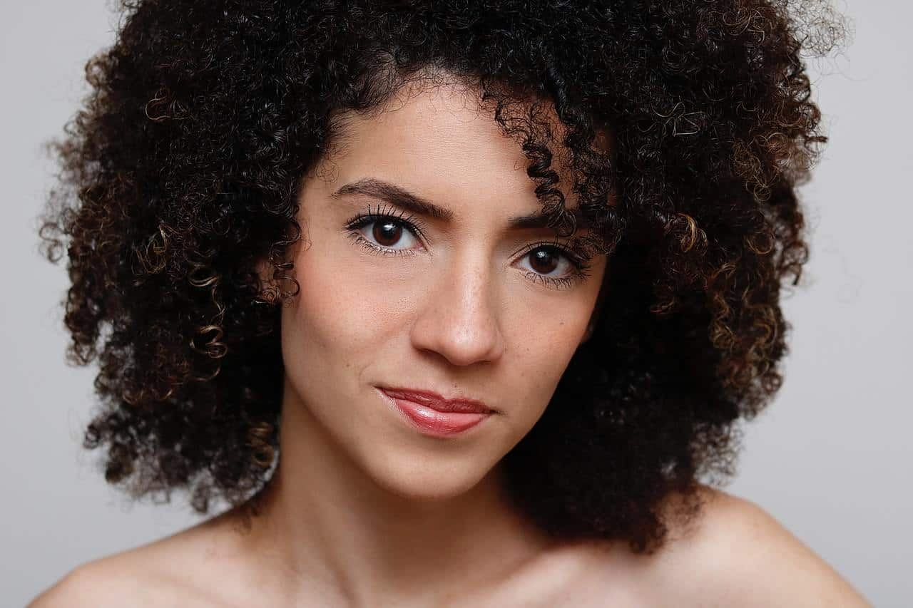 lady with clear skin and curly hair