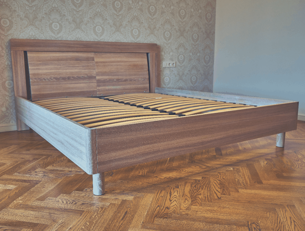 room with a wooden bed frame with frames
