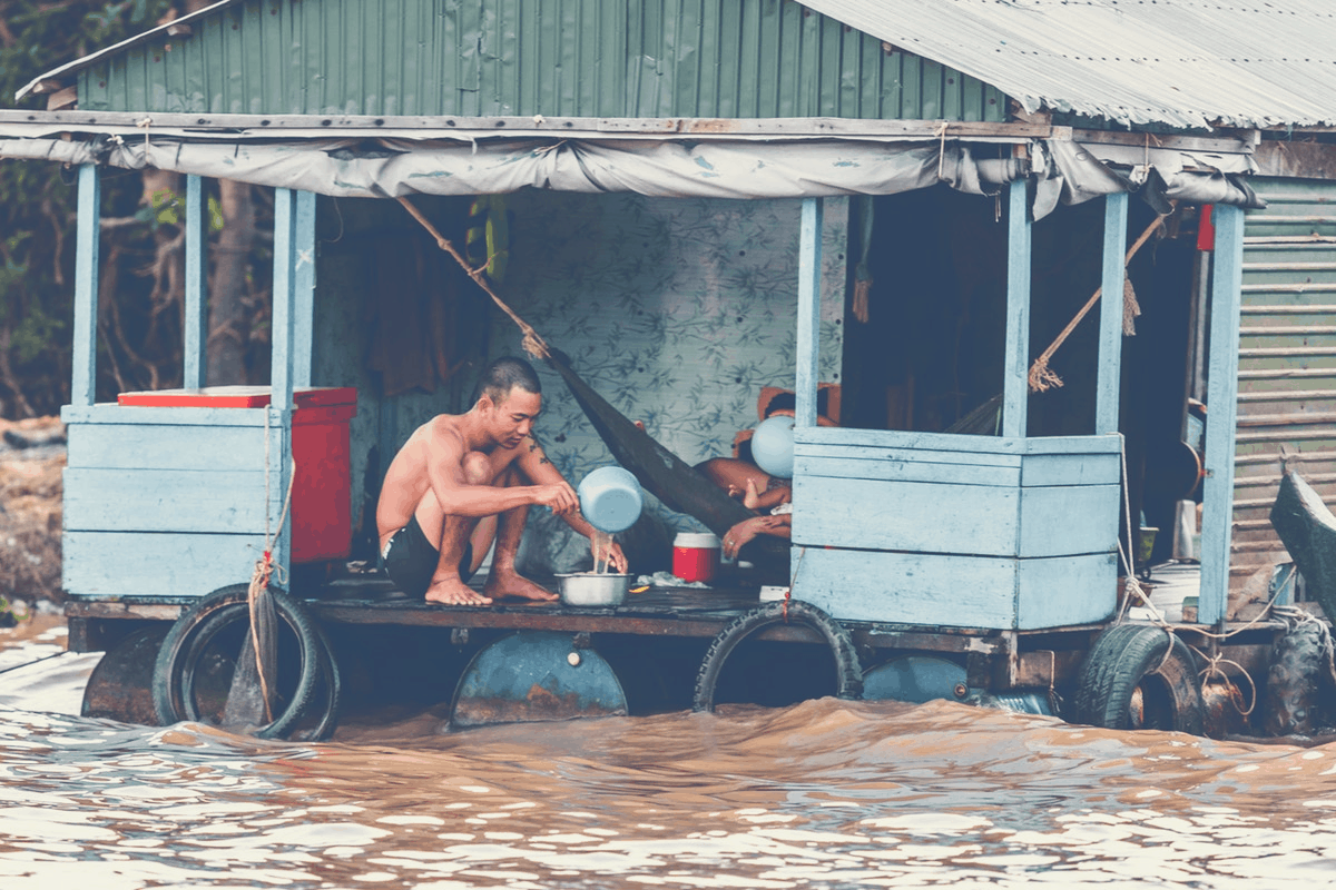 shirtless man in a flooded home