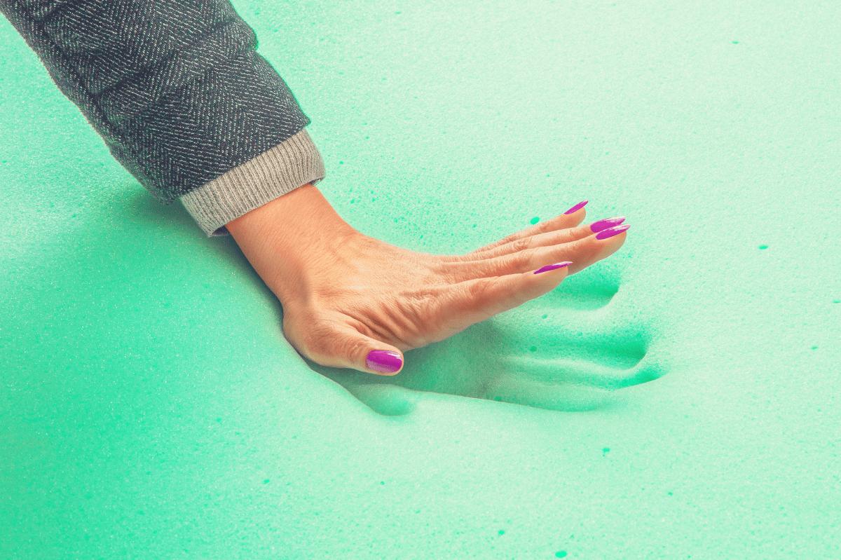 woman feeling the responsiveness of memory foam