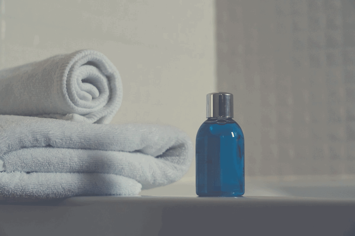 a couple of towels and sanitizer