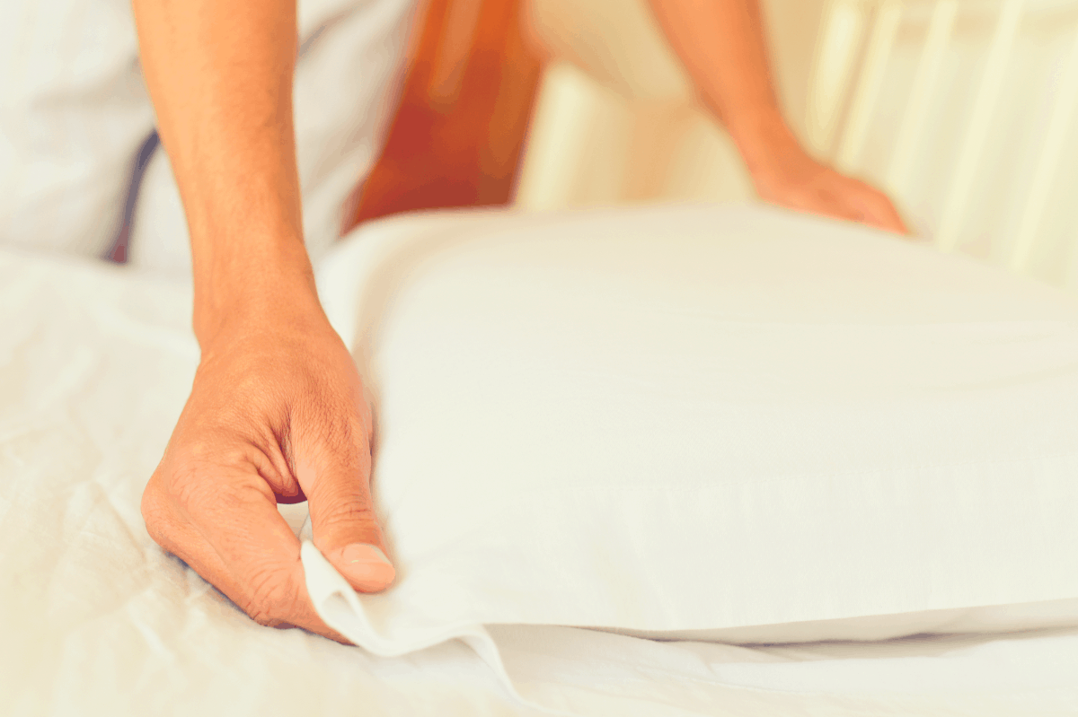 woman feeling her pillow case material
