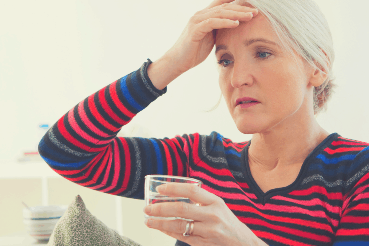 menopausal woman suffering hot flashes