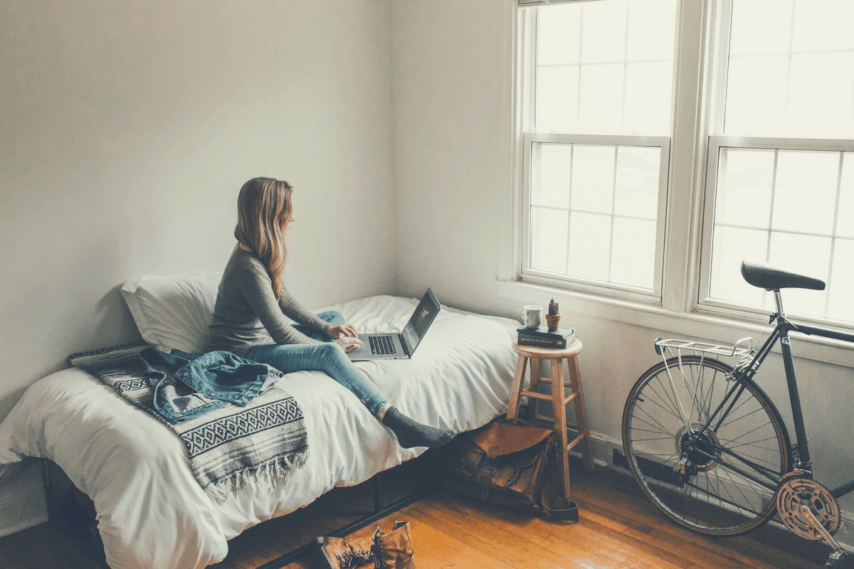 woman working on her laptop in bed