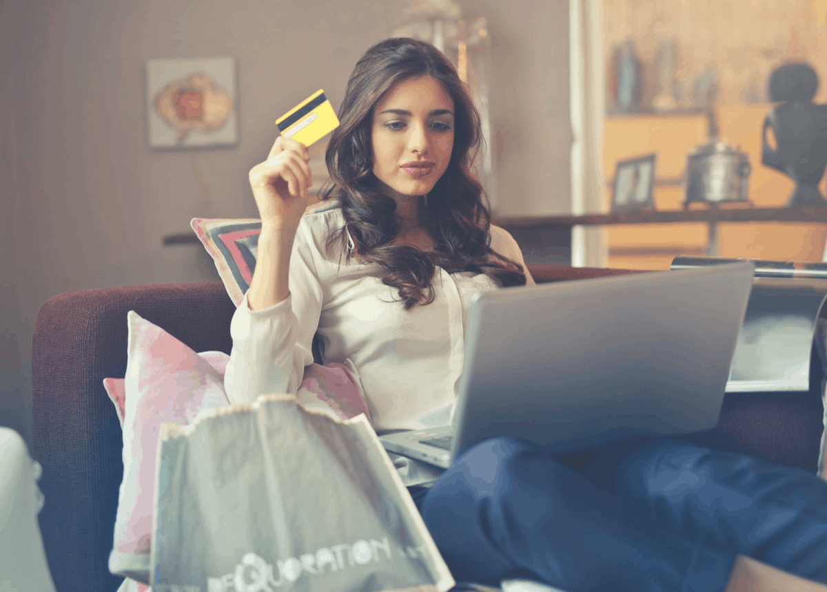 brunette with a credit card for online shopping