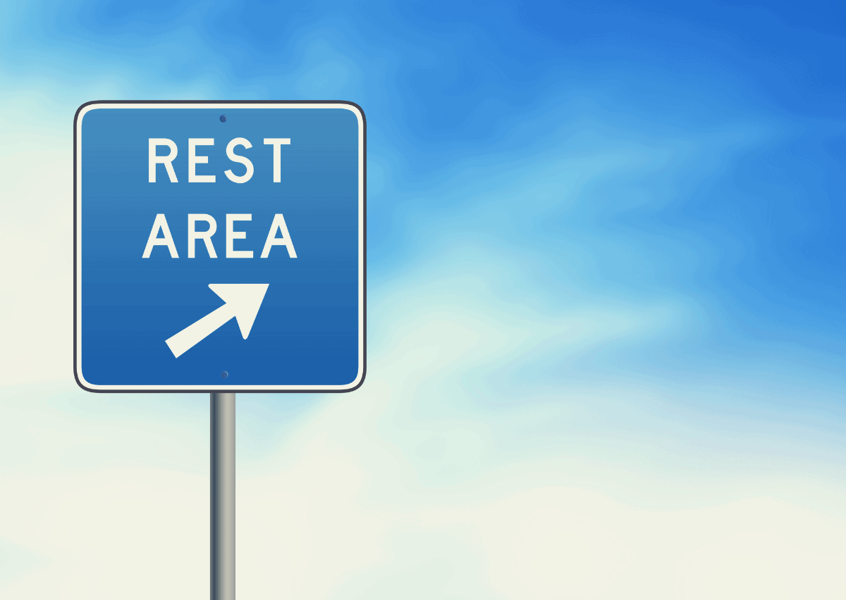 sign post to a rest stop
