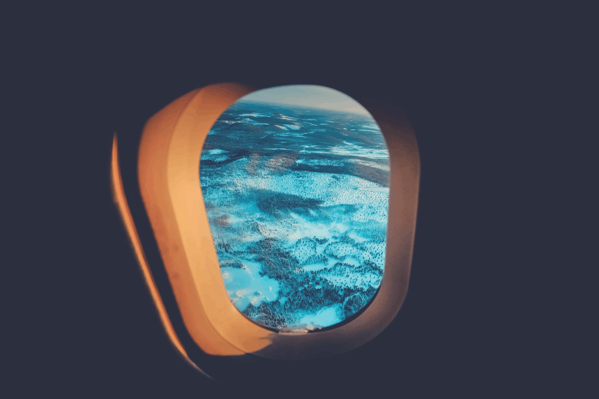 cloudy sky in an aircraft window