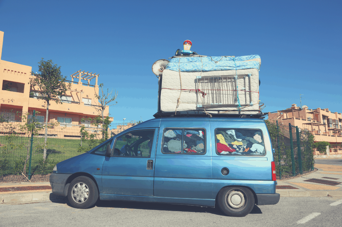 mattress loaded on top of a minivan without compression