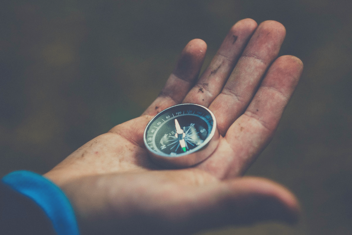 black man with compass in the palm