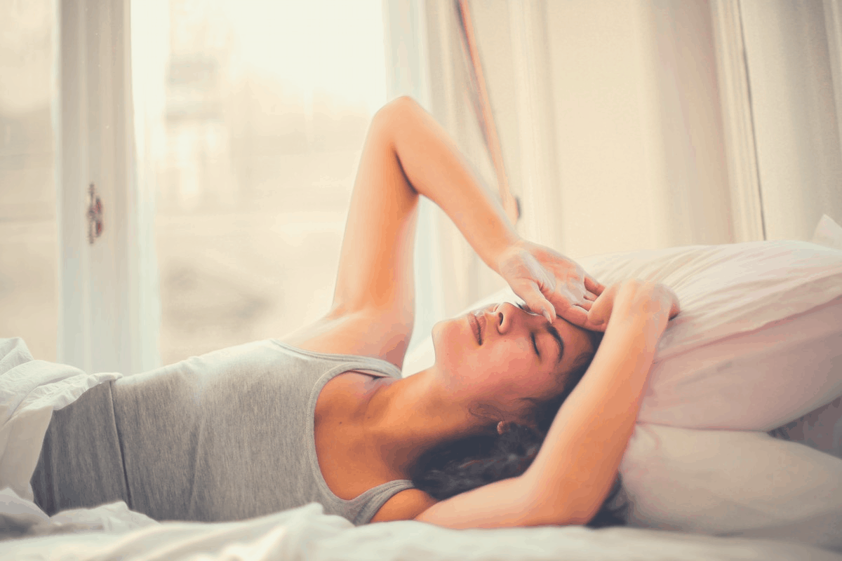 woman suffering from anxiety in bed