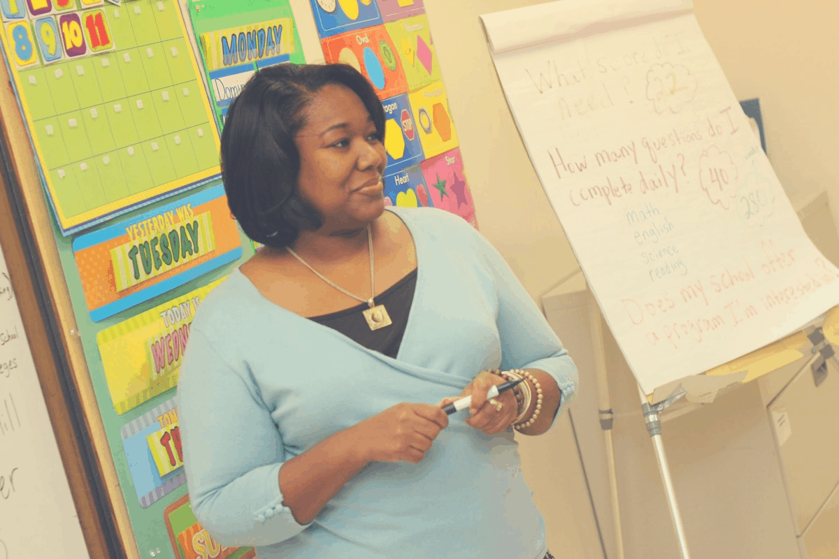 black woman standing in front of a class