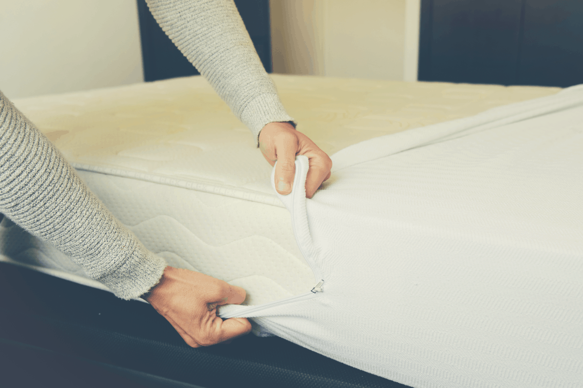 protector being wrapped on a mattress