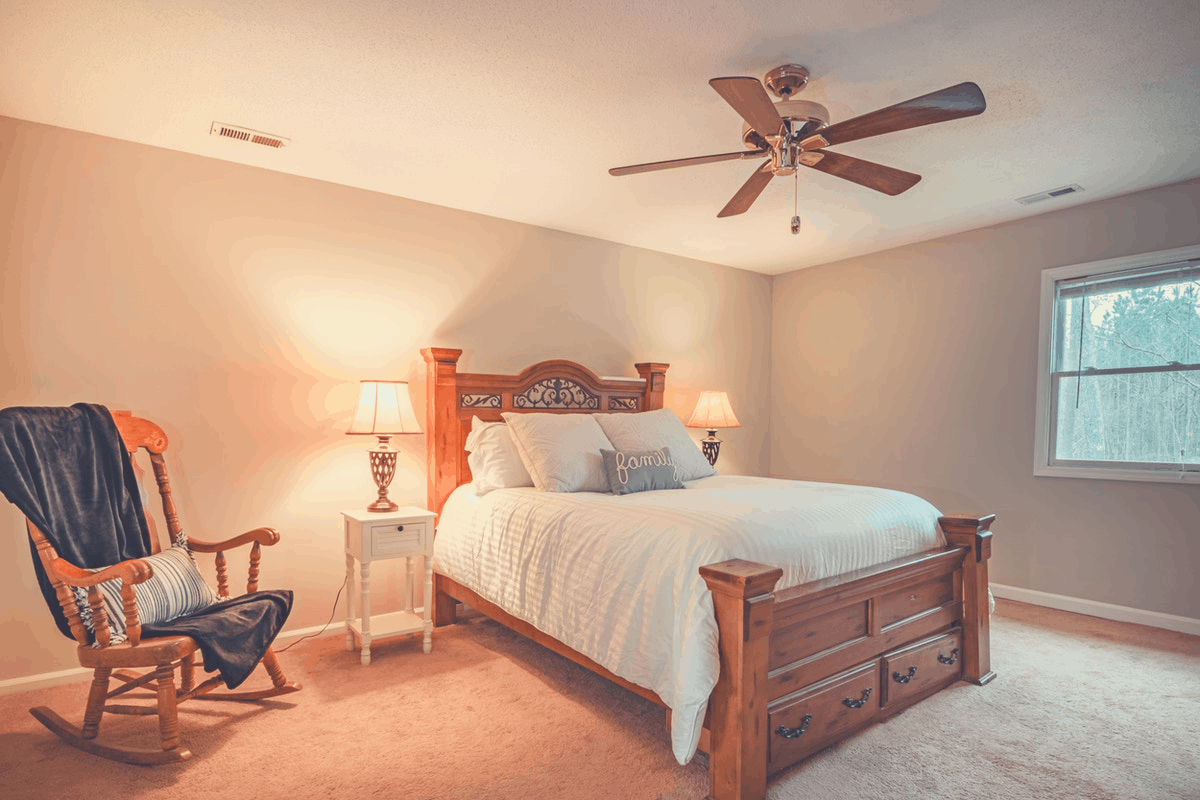 clean bedroom with ceiling fan