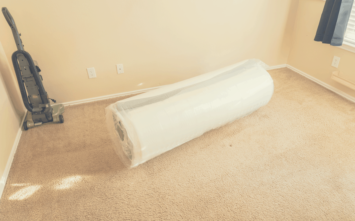 brand new compressed memory foam mattress on the floor
