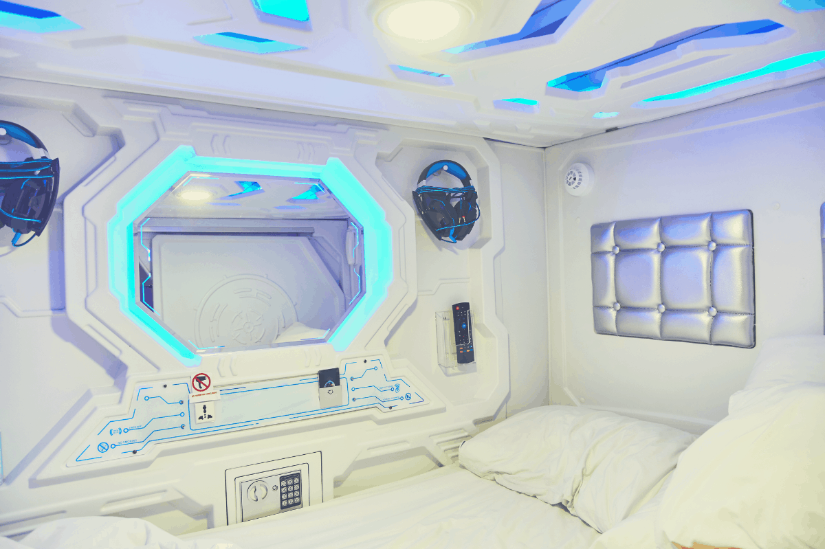 the interior of a sleep capsule with bed and pillows
