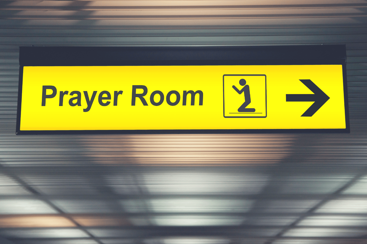 sign showing an airport prayer room