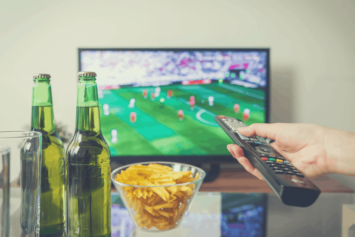 2 beer bottles in front of a TV