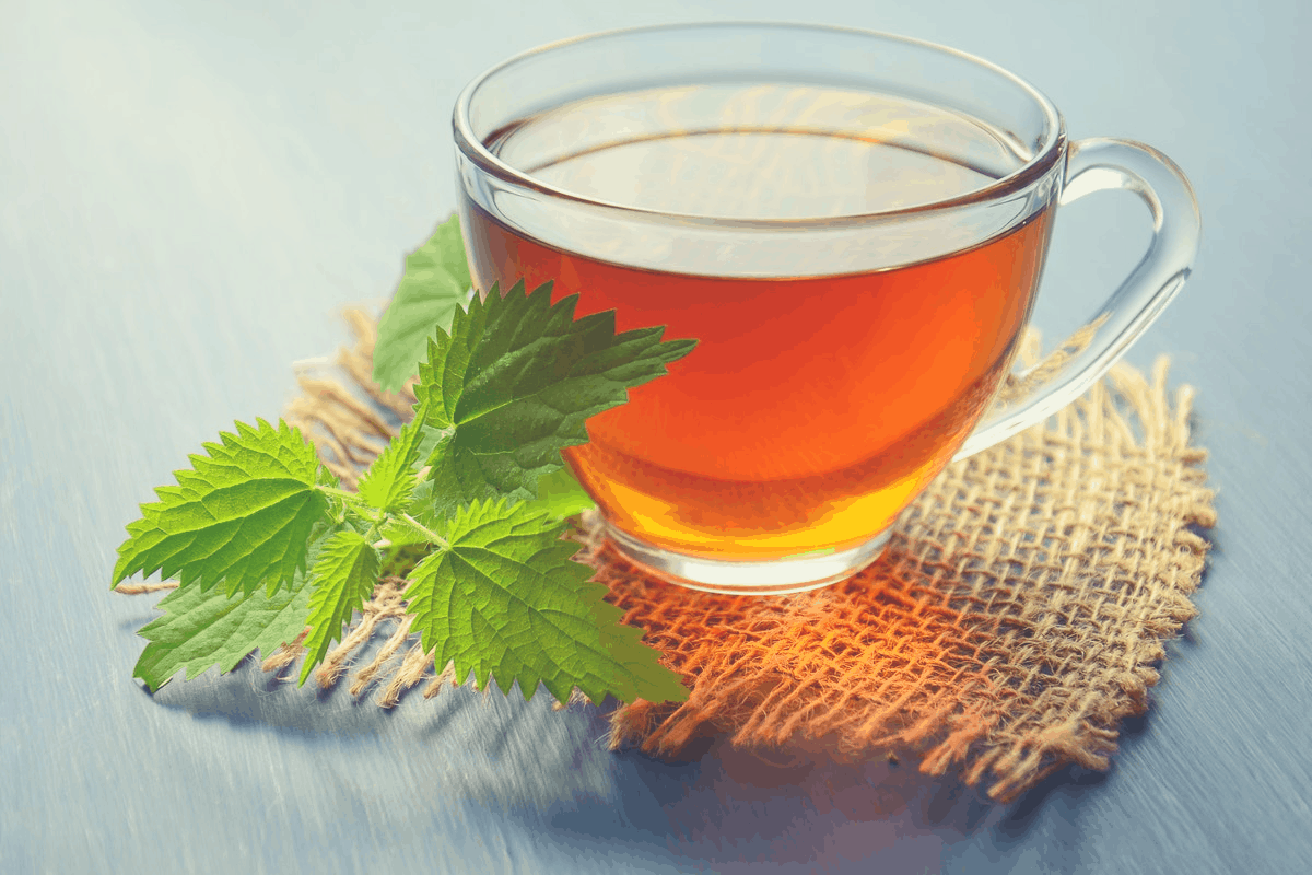 glass of tea with a green leaf