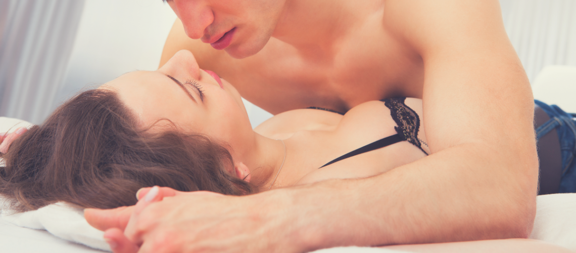 Flirty couple on a sex mattress getting in the mood