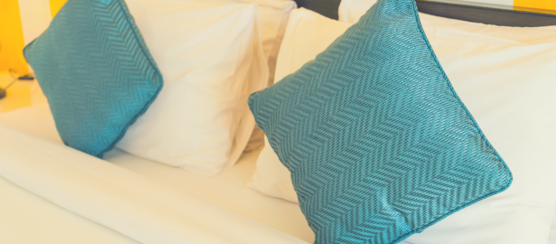 4 memory foam pillows in a large-sized bed