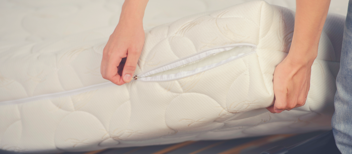 a cover being wrapped around a mattress