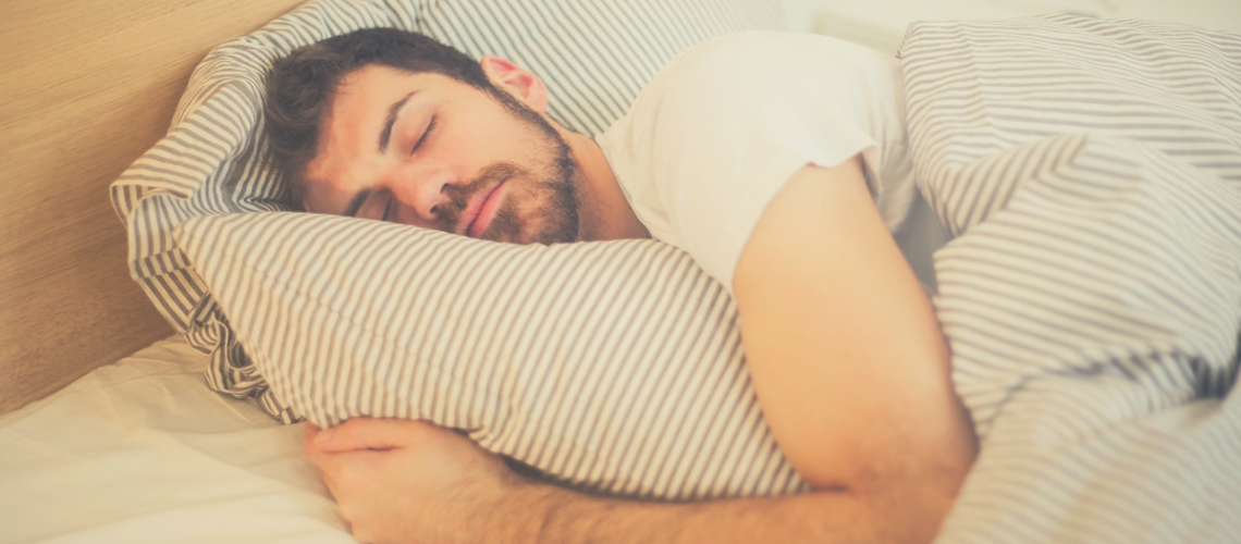 man lying on the side in bed